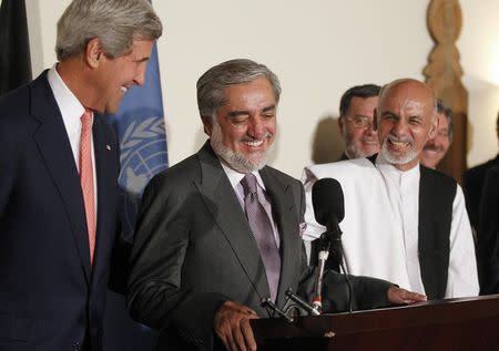 U.S. Secretary of State Kerry and Afghanistan's presidential candidates Abdullah and Ghani smile together after announcing a deal for the auditing of all Afghan election votes at the United Nations Compound in Kabul