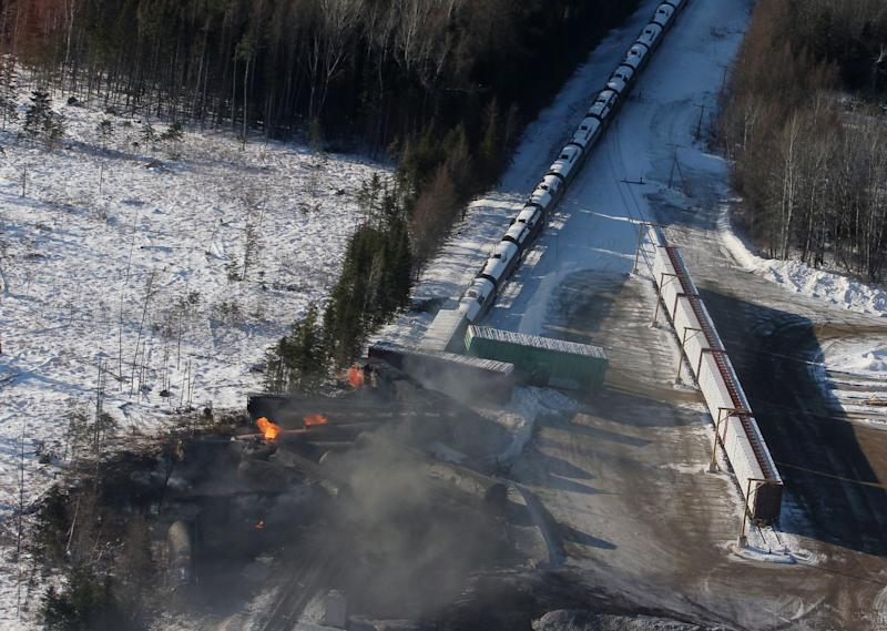 This aerial photo shows derailed train cars burning in Plaster Rock, New Brunswick on Wednesday, Jan. 8, 2014. A Canadian National Railway freight train carrying crude oil and propane derailed Tuesday night in a sparsely populated region of northwestern New Brunswick. More than 100 residents remained evacuated from their homes. There were no deaths or injuries. (AP Photo/The Canadian Press, Tom Bateman)