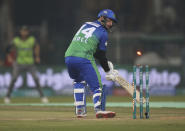 James Vince of Multan Sultans looks at his bails shattered by Shaheen Afridi of Lahore Qalandar in the Pakistan Super League match in Lahore, Pakistan, Friday, Feb. 21, 2020. (AP Photo/K.M. Chaudhry)