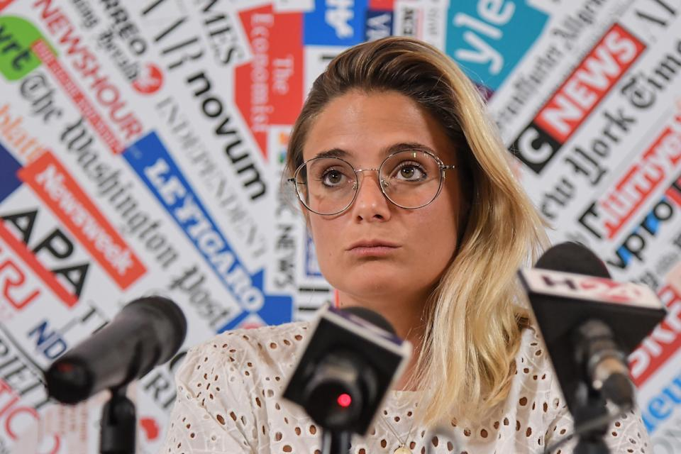 Giorgia Linardi, legal adviser in Italy for German hunmanitarian NGO Sea-Watch, attends a joint press conference of humanitarian NGOs Sea Watch, Doctors Without Borders (MSF), Open Arms and Tavolo Asilo on July 3, 2019 at the Foreign Press Association in Rome, following a decision to ban Sea Watch from a parliamentary hearing of NGOs within the government's second security decree aimed at giving more resources to police and judicial offices. - The German captain of a migrant rescue vessel, Carola Rackete, has gone into hiding following numerous threats, her charity Sea-Watch said on July 3, a day after her release from Italian custody. An Italian judge had on July 2 released Sea-Watch 3 captain Rackete, three days after her arrest for docking with 40 migrants aboard her ship in defiance of an Italian ban. (Photo by Tiziana FABI / AFP)        (Photo credit should read TIZIANA FABI/AFP via Getty Images) (Photo: TIZIANA FABI via Getty Images)