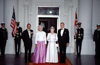 <p>The Queen and Prince Philip with the Bushes before a formal dinner. </p>