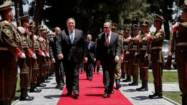 PHOTO: Secretary of State Mike Pompeo walks with Afghan President Ashraf Ghani's Chief of Staff Abdul Salam Rahimi, as he arrives at the Presidential Palace in Kabul, Afghanistan, June 25, 2019. (Jacquelyn Martin/Pool via Reuters)