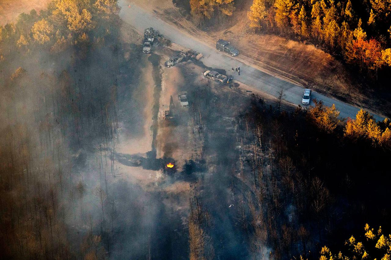 <p>A flame continues to burn after a Monday explosion of a Colonial Pipeline, Tuesday, Nov. 1, 2016, in Helena, Ala. The blast, which sent flames and thick black smoke soaring over the forest, happened about a mile west of where the pipeline ruptured in September, Gov. Robert Bentley said in a statement. (AP Photo/Brynn Anderson) </p>