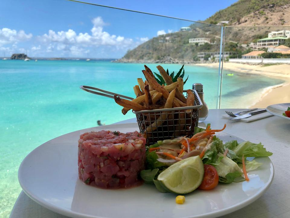 A plate of lunch on a seaside table at Sunset Cafe in St. Martin.