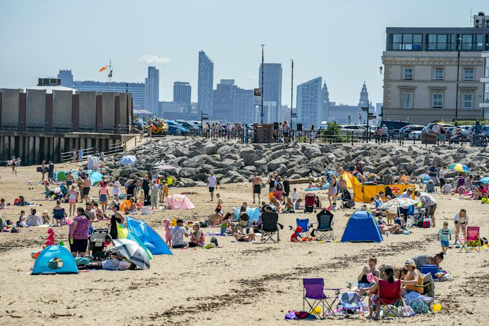 Sunbathers make the most of the mini heatwave in New Brighton, Wirral (Peter Byrne/PA) (PA Wire)