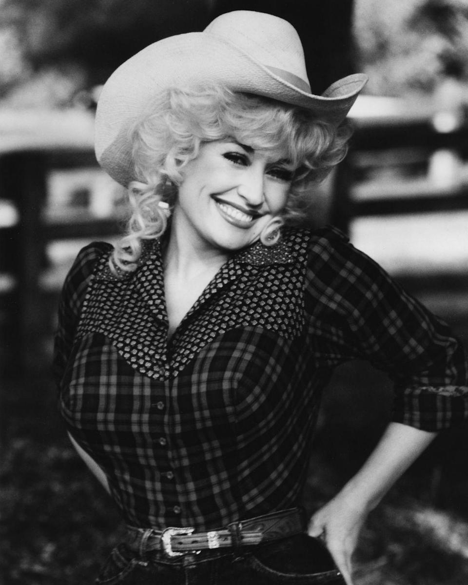 <p>With her ten-gallon hat, Dolly proves that she'll always be a country girl at heart.</p>
