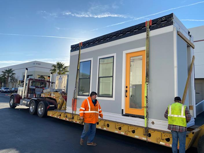 A Casita being moved as its strapped down to a platform