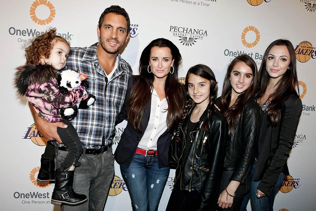"""Real Housewives of Beverly Hills"" star Kyle Richards -- who also happens to be Paris Hilton's aunt -- brought her hubby Mauricio Umansky and her four daughters to the event. Tibrina Hobson/<a href=""http://www.wireimage.com"" target=""new"">WireImage.com</a> - April 3, 2011"