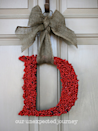 "<p>Faux berries turn a monogram into a special holiday display.<br></p><p><em><a href=""http://wwwourunexpectedjourney.blogspot.com/2011/11/let-decorating-begin.html"" rel=""nofollow noopener"" target=""_blank"" data-ylk=""slk:Get the tutorial at Our Unexpected Journey »"" class=""link rapid-noclick-resp"">Get the tutorial at Our Unexpected Journey »</a></em><br></p>"