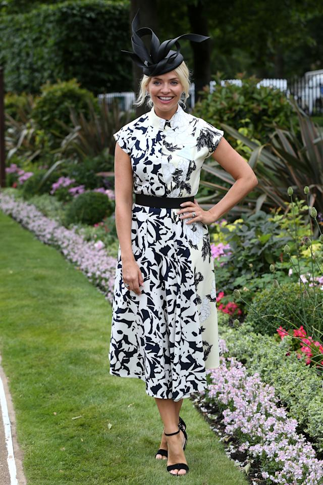 <p></p><p><span>Holly showed off her svelte figure in a floral Finery London number at Ascot. </span><em>[Photo: PA]</em> </p><p></p>