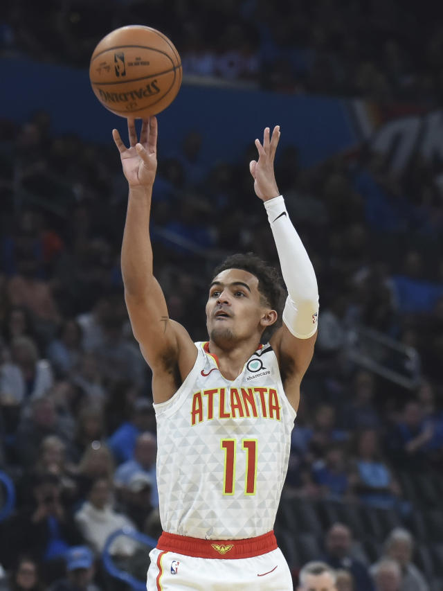 Atlanta Hawks guard Trae Young shoots in the first half of an NBA basketball game against Oklahoma City Thunder, Friday, Jan. 24, 2020, in Oklahoma City. (AP Photo/Kyle Phillips)