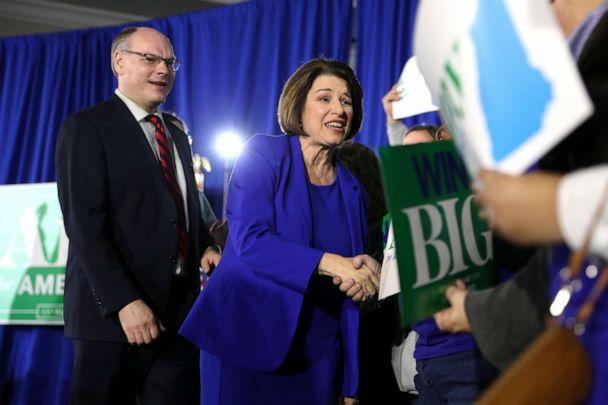 PHOTO: Sen. Amy Klobuchar (D-MN) takes the stage with her husband John Bessler as a Democratic president candidate during a primary night event at the Grappone Conference Center in Concord, New Hampshire, on Feb. 11, 2020. (Scott Eisen/Getty Images)