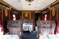 "<p>Each of the train's carriages is unique and has a colourful history. The interiors reflect the style and glamour of the 1920s and you can expect veneered panels that gleam, art deco lamps giving a soft light and polished brass.</p><p>Meanwhile, the unique armchairs offer a beautiful and comfortable place to sit as you take in the scenery and enjoy dinner, a drink or afternoon tea on the <a href=""https://www.countrylivingholidays.com/collection/belmond-british-pullman"" rel=""nofollow noopener"" target=""_blank"" data-ylk=""slk:British Pullman"" class=""link rapid-noclick-resp"">British Pullman</a>.</p>"