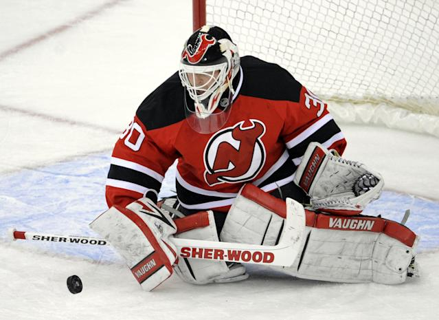 New Jersey Devils goaltender Martin Brodeur makes a save during the second period of an NHL hockey game against the Tampa Bay Lightning Tuesday, Oct. 29, 2013, in Newark, N.J. (AP Photo/Bill Kostroun)