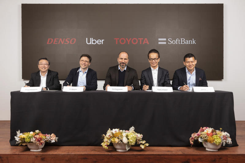 In this Thursday, April 18, 2019, photo provided by Toyota Motor Corporation, from left, Denso Corp. Executive Vice President Hiroyuki Wakabayashi, Head of Uber ATG Eric Meyhofer, CEO of Uber Technologies, Inc. Dara Khosrowshahi, Toyota Executive Vice President Shigeki Tomoyama and  Managing Partner of Softbank Vision Fund Ervin Tu attend a press conference at Uber headquarters in San Francisco. Japan's top automaker Toyota, auto parts maker Denso and internet company SoftBank's investment fund are investing $1 billion in car-sharing Uber's technology unit. (Toyota Motor Corporation via AP)