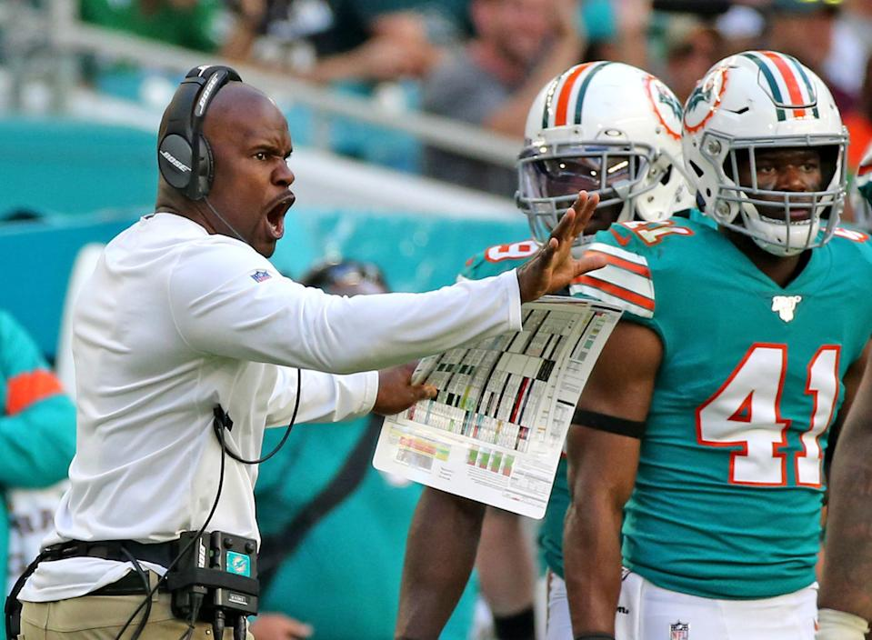 Miami Dolphins coach Brian Flores shouts from the sideline as they play the Philadelphia Eagles at Hard Rock Stadium Sunday, Dec. 1, 2019 in Miami Gardens, Fla. The Dolphins won, 37-31. (Al Diaz/Miami Herald/Tribune News Service via Getty Images)