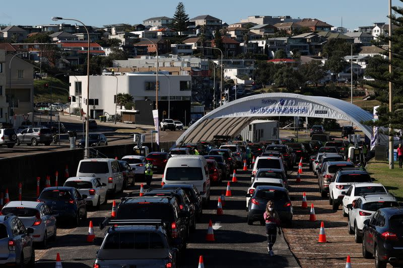 FILE PHOTO: Vehicles wait in line at the Bondi Beach COVID-19 testing centre in Sydney