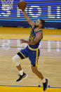 Golden State Warriors guard Stephen Curry (30) shoots against the Utah Jazz during the second half of an NBA basketball game in San Francisco, Monday, May 10, 2021. (AP Photo/Jeff Chiu)