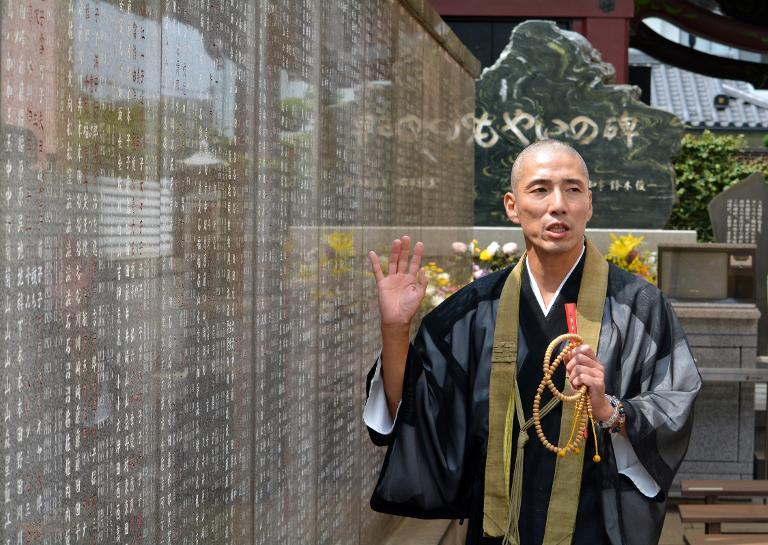 Ryukai Matsushima, a Buddhist priest whose father pioneered a movement of seeking gravemates, during an interview with AFP at his temple in Tokyo, June 4, 2014