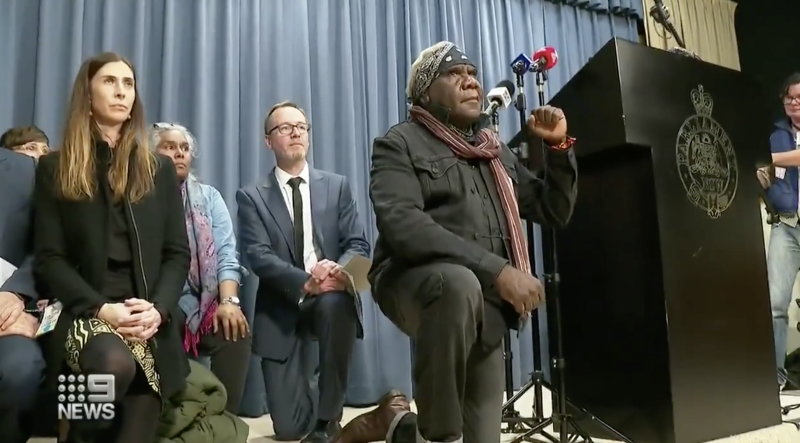 The Indigenous boy's family took a knee on stage during a press conference in Sydney.