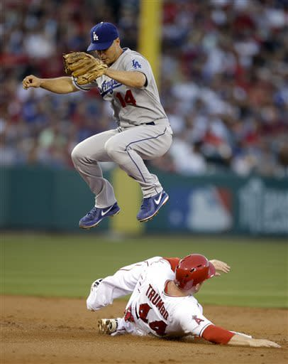 Los Angeles Dodgers' Mark Ellis, top, jumps over Los Angeles Angels' Mark Trumbo after forcing him out during the second inning of an interleague baseball game in Anaheim, Calif., Thursday, May 30, 2013. (AP Photo/Jae C. Hong)