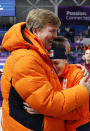 <p>Gold medallist Ireen Wust of Netherlands, right, is hugged by Dutch King Willem-Alexander after the women's 1,500 meters speedskating race at the Gangneung Oval at the 2018 Winter Olympics in Gangneung, South Korea, Monday, Feb. 12, 2018. (AP Photo/Vadim Ghirda) </p>