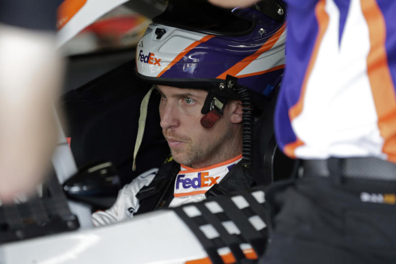 Denny Hamlin waits in his car during practice for Sunday's NASCAR Cup Series auto race at Charlotte Motor Speedway in Concord, N.C., Saturday, Sept. 28, 2019. (AP Photo/Gerry Broome)