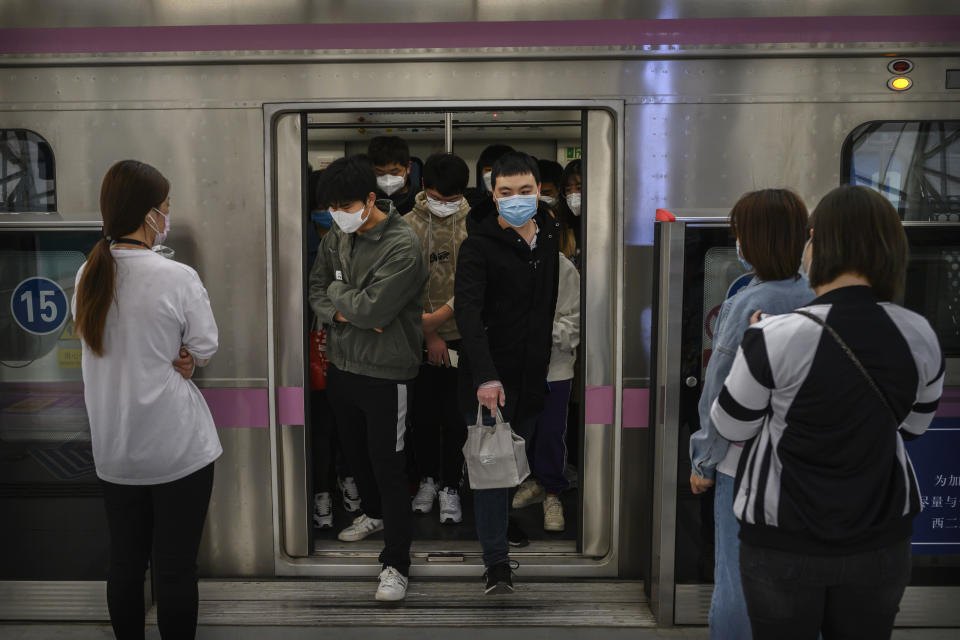 BEIJING, CHINA - APRIL 15: Chinese commuters wear protective masks as they exit the subway during rush hour on April 15, 2020 in Beijing, China. China lifted its lockdown on Wuhan, the first epicentre of COVID-19 after 76 days last week, allowing healthy people to leave. With the pandemic hitting hard across the world, officially the number of coronavirus cases in China is dwindling, ever since the government imposed sweeping measures to keep the disease from spreading.  For more than two months, millions of people across China have been restricted in how they move from their homes, while other cities have been locked down in ways that appeared severe at the time but are now being replicated in other countries trying to contain the virus. Officials believe the worst appears to be over in China, though there are concerns of another wave of infections as the government attempts to reboot the worlds second largest economy. Since January, China has recorded more than 81,000 cases of COVID-19 and at least 3200 deaths, mostly in and around the city of Wuhan, in central Hubei province, where the outbreak first started. (Photo by Kevin Frayer/Getty Images)