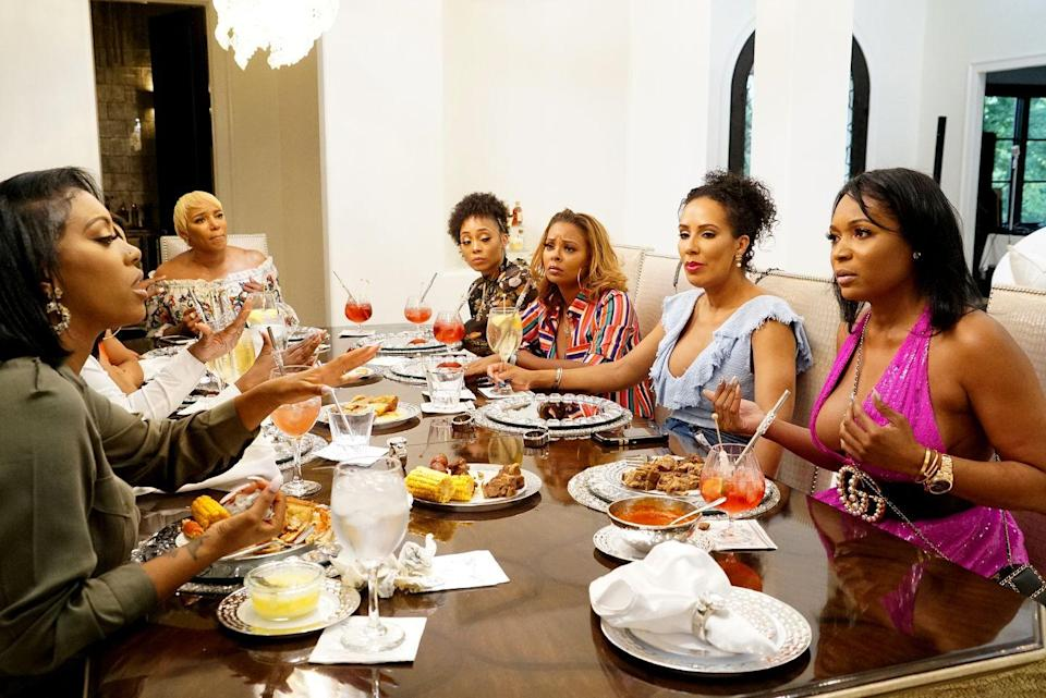"""<p>Producers choose where the women will sit beforehand, which is why feuding 'wives usually end up near each other. """"Sometimes the whole cast knows where they're sitting, and sometimes they don't know. Sometimes just a few know,"""" a producer told <a href=""""https://www.businessinsider.com/reality-show-secrets-2016-4#place-them-like-chess-pieces-4"""" rel=""""nofollow noopener"""" target=""""_blank"""" data-ylk=""""slk:Business Insider"""" class=""""link rapid-noclick-resp""""><em>Business Insider</em></a>. </p>"""