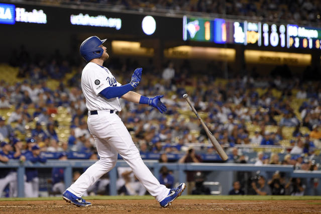 Los Angeles Dodgers' Max Muncy drops his bat after hitting a game-ending solo home run during the 10th inning of the the team's baseball game against the Toronto Blue Jays on Wednesday, Aug. 21, 2019, in Los Angeles. The Dodgers won 2-1. (AP Photo/Mark J. Terrill)