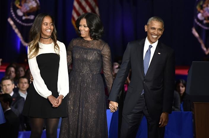 The Obamas with their eldest daughter, Malia.  (Photo: Bloomberg via Getty Images)