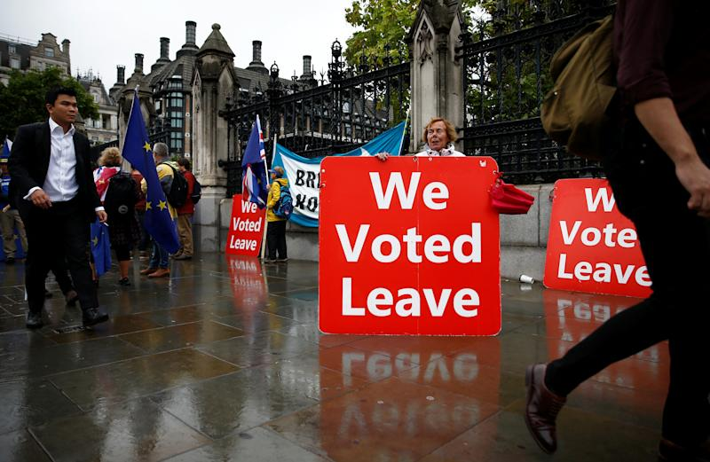 A pro-Brexit protester holds a placard in Westminster, London, Britain September 25, 2019. REUTERS/Henry Nicholls