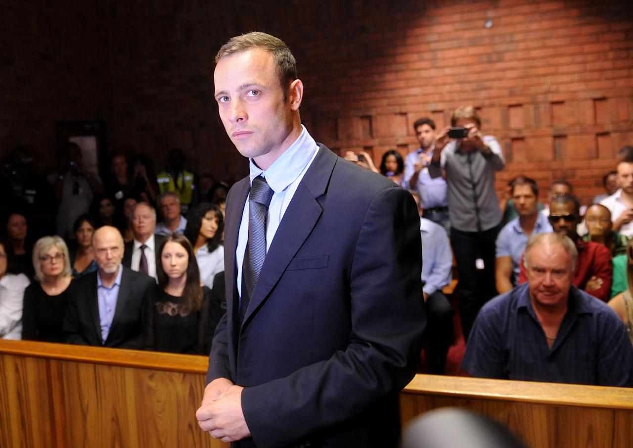 Olympic athlete, Oscar Pistorius , in court Friday Feb. 22, 2013 in Pretoria, South Africa, for his bail hearing charged with the shooting death of his girlfriend, Reeva Steenkamp. The defense and prosecution both completed their arguments with the magistrate soon to rule if the double-amputee athlete can be freed before trial or if he must stay behind bars pending trial. (AP Photo/Antoine de Ras-Star) SOUTH AFRICA OUT