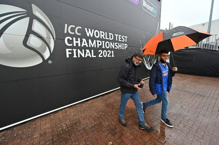 Staying on - India fans walk in the rain on the fourth day of the World Test Championship final against New Zealand and India at Southampton on Monday