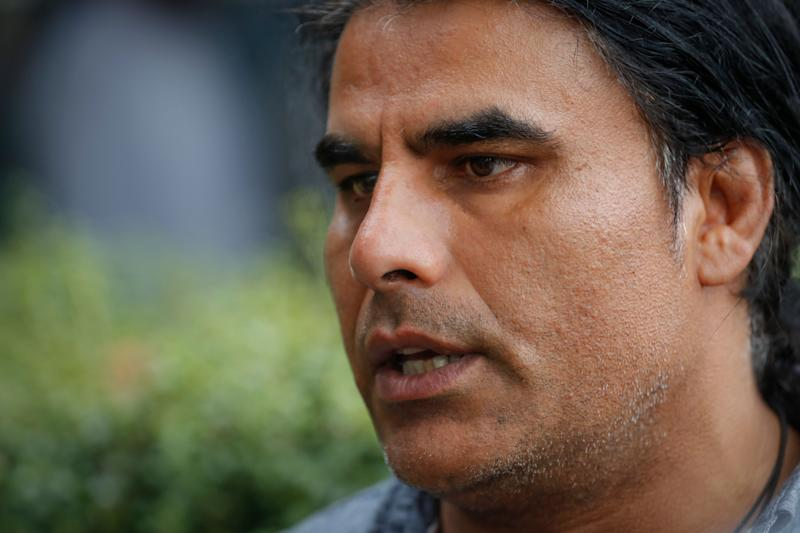 Abdul Aziz, survivor of mosque shooting speaks to Associated Press during an interview in Christchurch, New Zealand, Saturday, March 16, 2019. Aziz, 48, is being hailed as a hero for preventing more deaths during Friday prayers at the Linwood mosque in Christchurch. The gunman killed 49 people after attacking two mosques in the deadliest mass shooting in New Zealand's modern history. Seven were killed at the Linwood mosque. (AP Photo/Vincent Thian) ORG XMIT: BKWS104