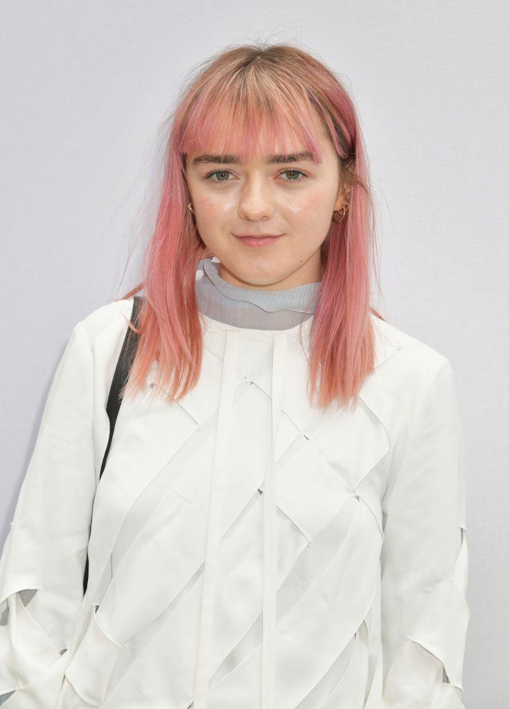 "<p>Make a major statement by fading golden blonde hair into a bold pink-leaning peach. To pack an even bigger punch, ask for an <a href=""https://www.goodhousekeeping.com/beauty/hair/g2942/ombre-hair-color-ideas/"" rel=""nofollow noopener"" target=""_blank"" data-ylk=""slk:ombré"" class=""link rapid-noclick-resp"">ombré</a> effect on your bangs, too, like <strong>Maisie Williams</strong>.</p><p><a class=""link rapid-noclick-resp"" href=""https://www.amazon.com/Arctic-Fox-Semi-Permanent-Hair-Colors/dp/B083TN9HR1?th=1&tag=syn-yahoo-20&ascsubtag=%5Bartid%7C10055.g.35154692%5Bsrc%7Cyahoo-us"" rel=""nofollow noopener"" target=""_blank"" data-ylk=""slk:SHOP PINK DYE"">SHOP PINK DYE</a></p>"