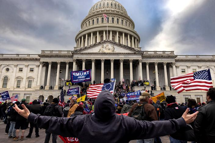 A mob of unambiguous Trump supporters stands outside the Capitol on Jan. 6. (Photo: Brent Stirton via Getty Images)