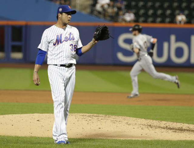 New York Mets relief pitcher Anthony Swarzak (38) reacts as Miami Marlins' JT Riddle (10) runs the bases after hitting a home run during the eighth inning of a baseball game Tuesday, Sept. 11, 2018, in New York. (AP Photo/Frank Franklin II)