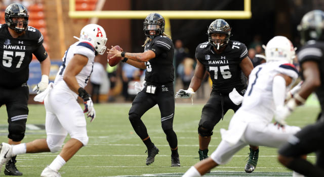 Hawaii quarterback Cole McDonald (13) looks looks for a receiver during the second quarter of the team's NCAA college football game against Arizona on Saturday, Aug. 24, 2019, in Honolulu. (AP Photo/Marco Garcia)