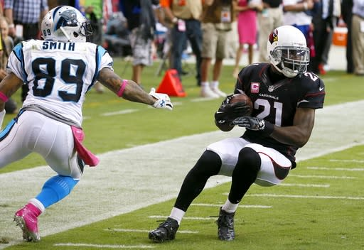 Arizona Cardinals' Patrick Peterson (21) intercepts a ball intended for Carolina Panthers' Steve Smith (89) in the first half of an NFL football game on Sunday, Oct. 6, 2013, in Glendale, Ariz. (AP Photo/Ross D. Franklin)