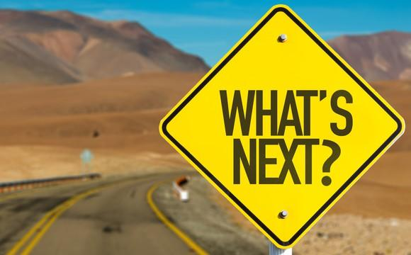 A sign on a road saying what's next?