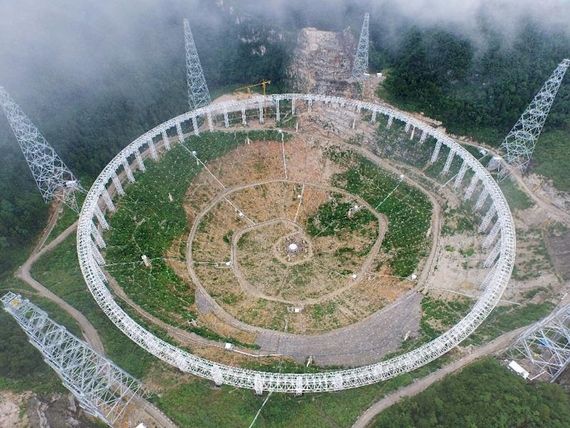 The five-hundred-metre Aperture Spherical Radio Telescope (FAST), nestled between hills in the southwestern province of Guizhou, is due to start operation this year