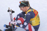 United States' Jessie Diggins cries after completing a women's Tour de Ski, cross-country 10K mass start event, in Val di Fiemme, Italy, Sunday, Jan. 10, 2021. (AP Photo/Alessandro Trovati)