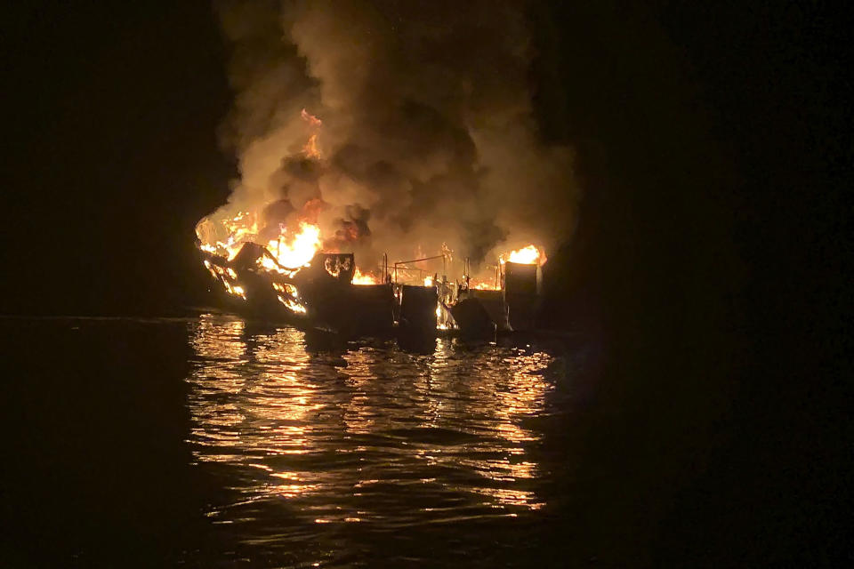 FILE - In this Sept. 2, 2019, file photo provided by the Santa Barbara County Fire Department, the dive boat Conception is engulfed in flames after a deadly fire broke out aboard the commercial scuba diving vessel off the Southern California Coast. The captain of a scuba diving boat that burned and sank off the California coast, killing 34 people below deck, has pleaded not guilty to federal manslaughter charges. Jerry Boylan surrendered Tuesday, Feb. 16, 2021, and was arraigned in Los Angeles federal court on 34 counts of seaman's manslaughter. (Santa Barbara County Fire Department via AP, File)