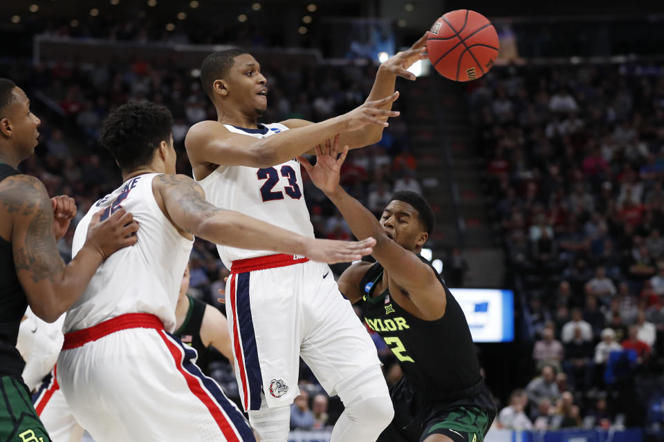 <p>Gonzaga guard Zach Norvell Jr. (23) passes against Baylor guard Jared Butler, right, during the first half of a second-round game in the NCAA men's college basketball tournament Saturday, March 23, 2019, in Salt Lake City. (AP Photo/Jeff Swinger) </p>