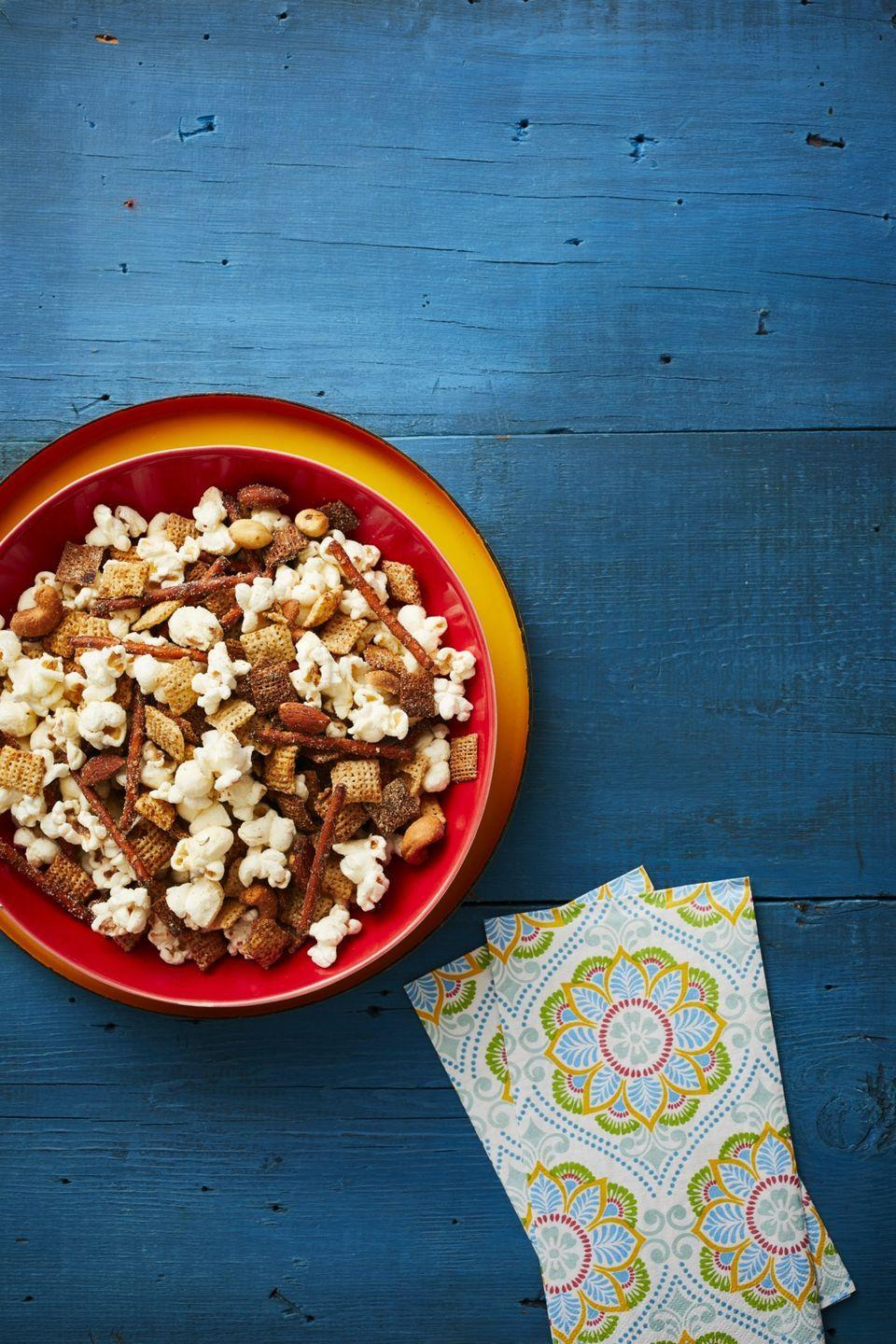 """<p>It's always smart to have a classic snack mix on hand at a party. This garlic and ranch one will be a hit—and the bowl will likely be empty in 10 minutes.</p><p><strong><a href=""""https://www.thepioneerwoman.com/food-cooking/recipes/a32257430/garlic-ranch-party-mix-recipe/"""" rel=""""nofollow noopener"""" target=""""_blank"""" data-ylk=""""slk:Get the recipe."""" class=""""link rapid-noclick-resp"""">Get the recipe.</a></strong></p><p><strong><a class=""""link rapid-noclick-resp"""" href=""""https://go.redirectingat.com?id=74968X1596630&url=https%3A%2F%2Fwww.walmart.com%2Fsearch%2F%3Fquery%3Dpioneer%2Bwoman%2Bserving%2Bbowls&sref=https%3A%2F%2Fwww.thepioneerwoman.com%2Ffood-cooking%2Fmeals-menus%2Fg34272733%2Fchristmas-party-appetizers%2F"""" rel=""""nofollow noopener"""" target=""""_blank"""" data-ylk=""""slk:SHOP SERVING BOWLS"""">SHOP SERVING BOWLS</a><br></strong></p>"""