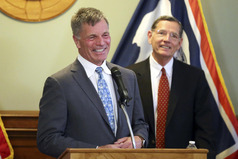 Wyoming Gov. Mark Gordon, left, shares a smile with U.S. John Barrasso, R-Wyo., during the press conference, Wednesday, June 2, 2021, at the Wyoming Capitol in Cheyenne, Wyo., announcing efforts to advance a Natrium reactor demonstration project at a retiring coal plant. A next-generation, small nuclear plant will be built at a soon-to-be retired coal-fired power plant in Wyoming in the next several years, business and government officials said Wednesday. (Michael Cummo/The Wyoming Tribune Eagle via AP)