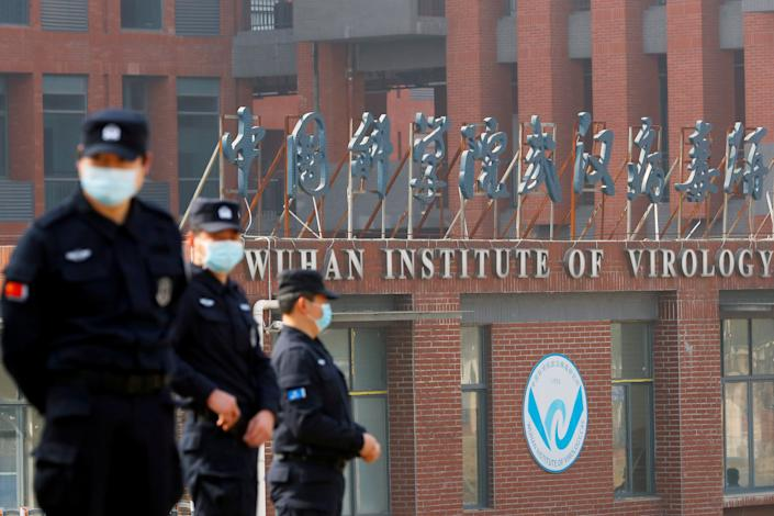 Security personnel keep watch outside the Wuhan Institute of Virology during the visit by the World Health Organization (WHO) team tasked with investigating the origins of the coronavirus disease (COVID-19), inWuhan, Hubei province, China February 3, 2021. (Thomas Peter/Reuters)