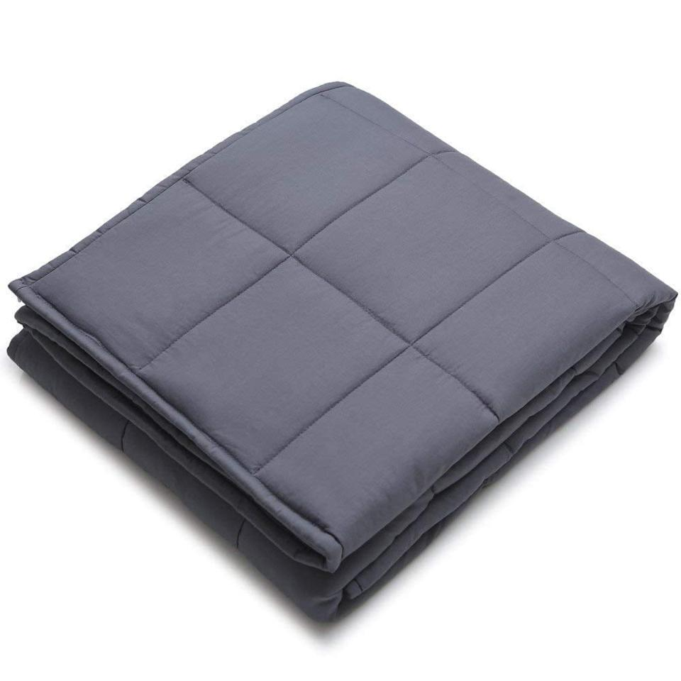 "<p>This <a href=""https://www.popsugar.com/buy/YnM-Weighted-Blanket-371795?p_name=YnM%20Weighted%20Blanket&retailer=amazon.com&pid=371795&price=63&evar1=savvy%3Aus&evar9=43444323&evar98=https%3A%2F%2Fwww.popsugar.com%2Fsmart-living%2Fphoto-gallery%2F43444323%2Fimage%2F47421449%2FYnM-Weighted-Blanket&list1=shopping%2Cgifts%2Camazon%2Cgift%20guide%2Cvalentines%20day%2Cgifts%20for%20women&prop13=mobile&pdata=1"" rel=""nofollow"" data-shoppable-link=""1"" target=""_blank"" class=""ga-track"" data-ga-category=""Related"" data-ga-label=""https://www.amazon.com/YnM-Weighted-Blanket-Material-Insomnia/dp/B073429DV2"" data-ga-action=""In-Line Links"">YnM Weighted Blanket</a> ($63) will keep her warm and comforted and is perfect for a movie marathon.</p>"