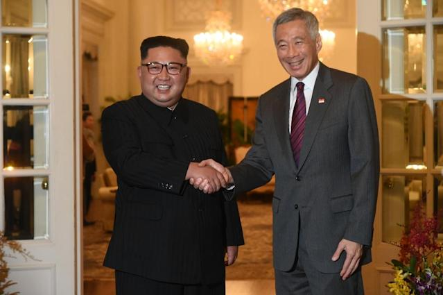 <p>North Korean leader Kim Jong Un and Singapore's Prime Minister Lee Hsien Loong shake hands at the Istana. (PHOTO: AFP) </p>